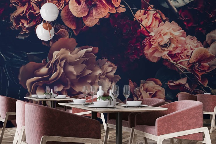 pink and purple dark flower wallpaper in restaurant with dusty pink comfy chairs