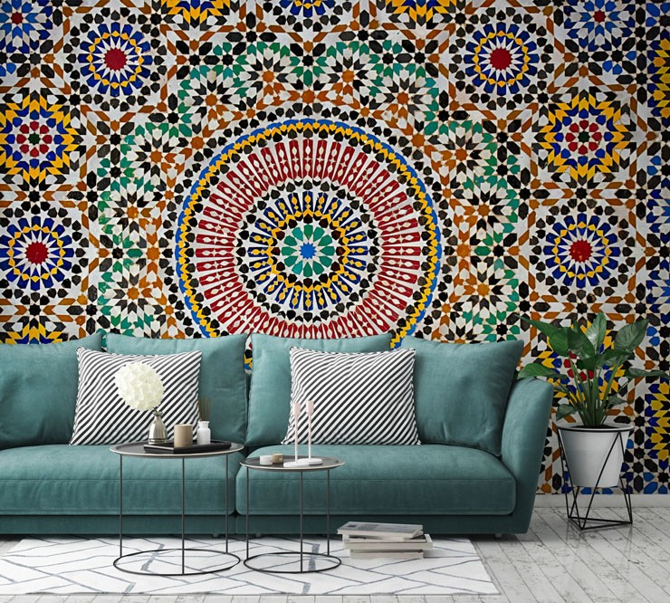 multicoloured circular moroccan style tile wallpaper in room with turquoise sofa
