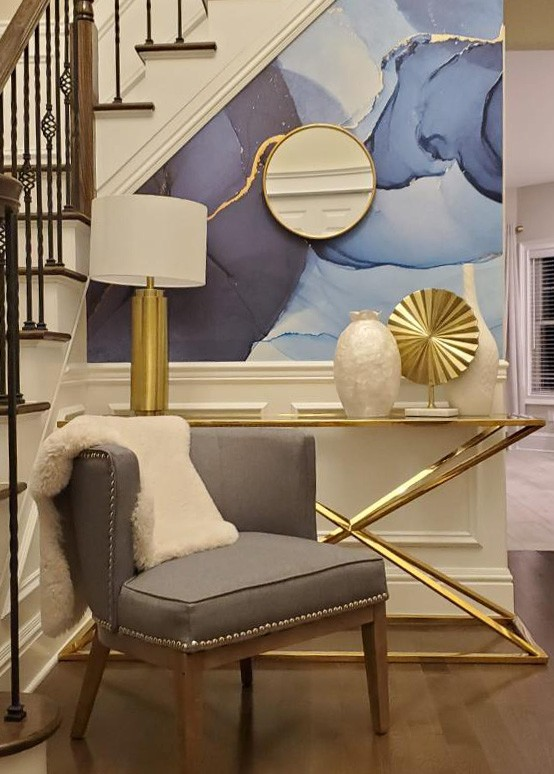 blue, white and gold watercolour wallpaper in hallway with gold decor
