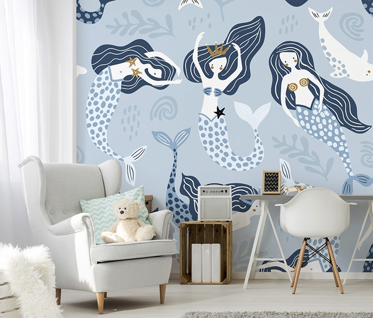 blue and white mermaid and dolphin wallpaper in cosy childs bedroom