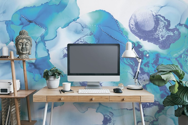 blue and white marble effect wallpaper in calm home office with wooden desk, buddha head and green plants