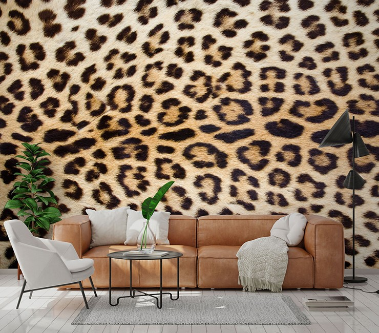 close up photo of jaguar print wallpaper in lounge with brown leather sofa