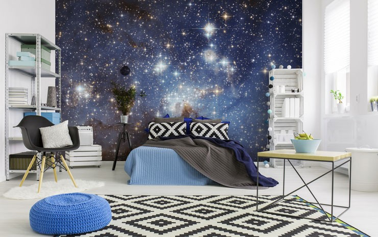 blue starry galaxy sky wall mural in trendy open loft bedroom