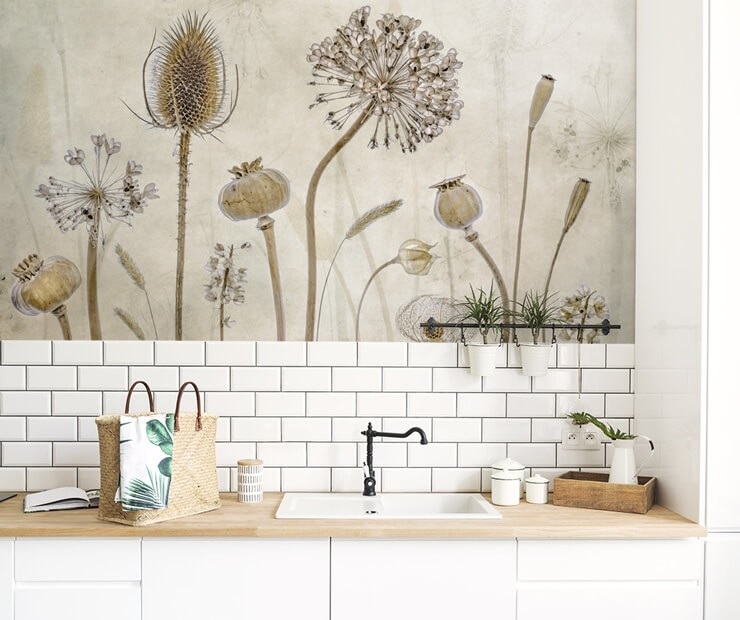 dried flowers photograph wallpaper above white tile splash back in trendy kitchen