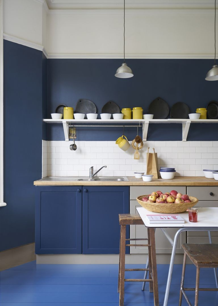 navy blue and white painted walls in sleek kitchen with yellow accessories
