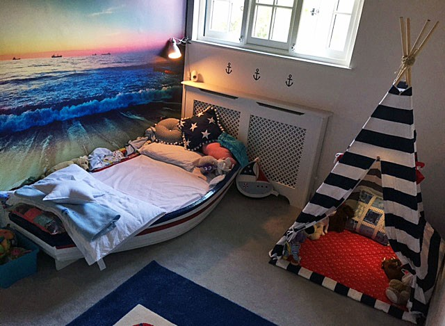 calming sunset beach wall mural in child's pirate bedroom