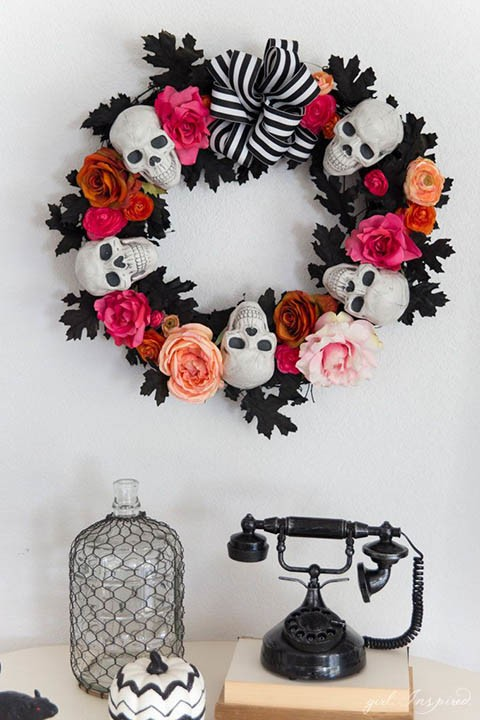 white skull, pink flowers and black halloween wreath