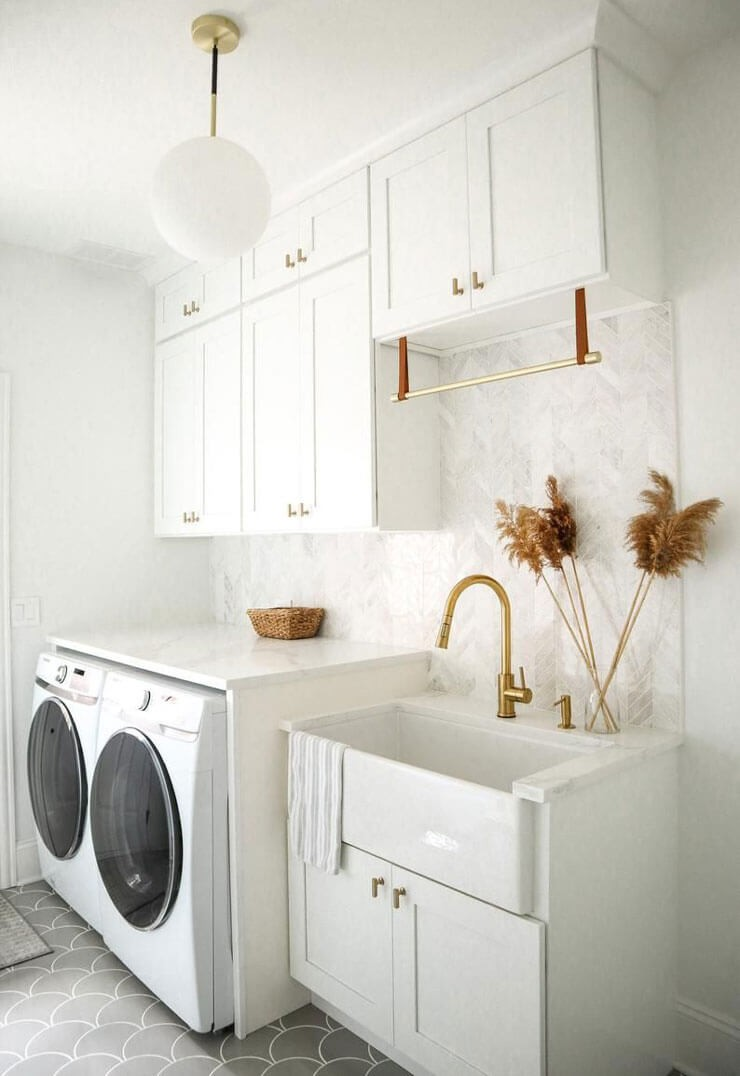 off-white laundry room with old, deep sink