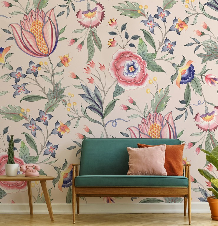 pale pink floral wallpaper with touches of blue and orange in trendy living room