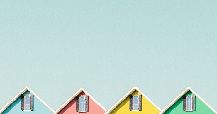 pink, blue, green and yellow house roof tops