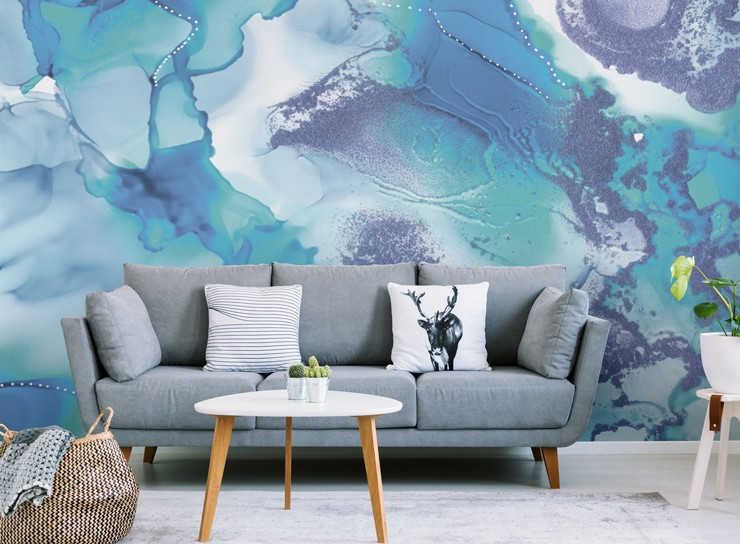 blue and white abstract art wallpaper in lounge with grey sofa
