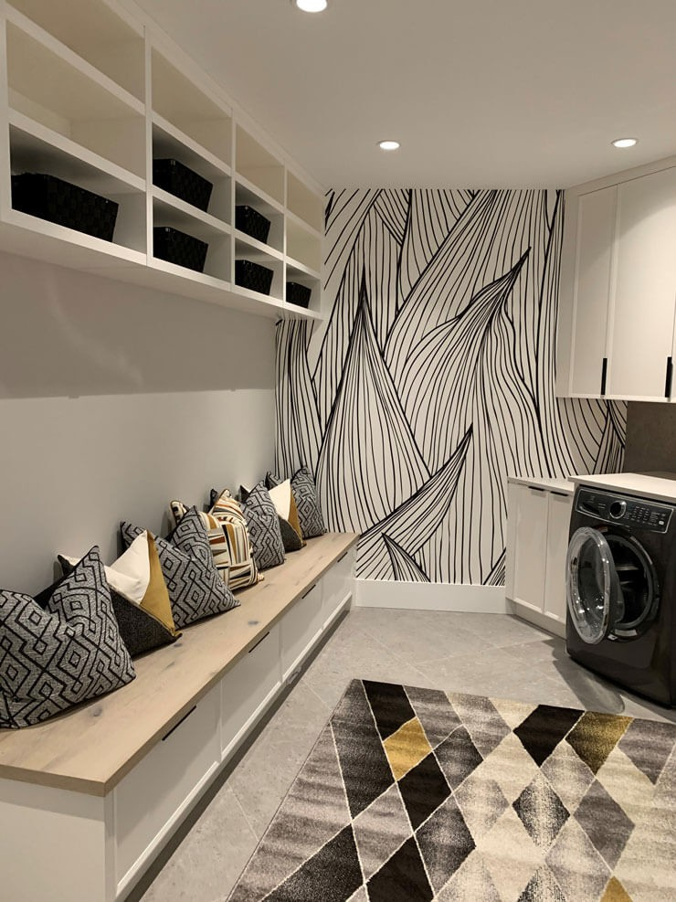 black and white leaf illustration wallpaper in gold, grey and black laundry mudroom
