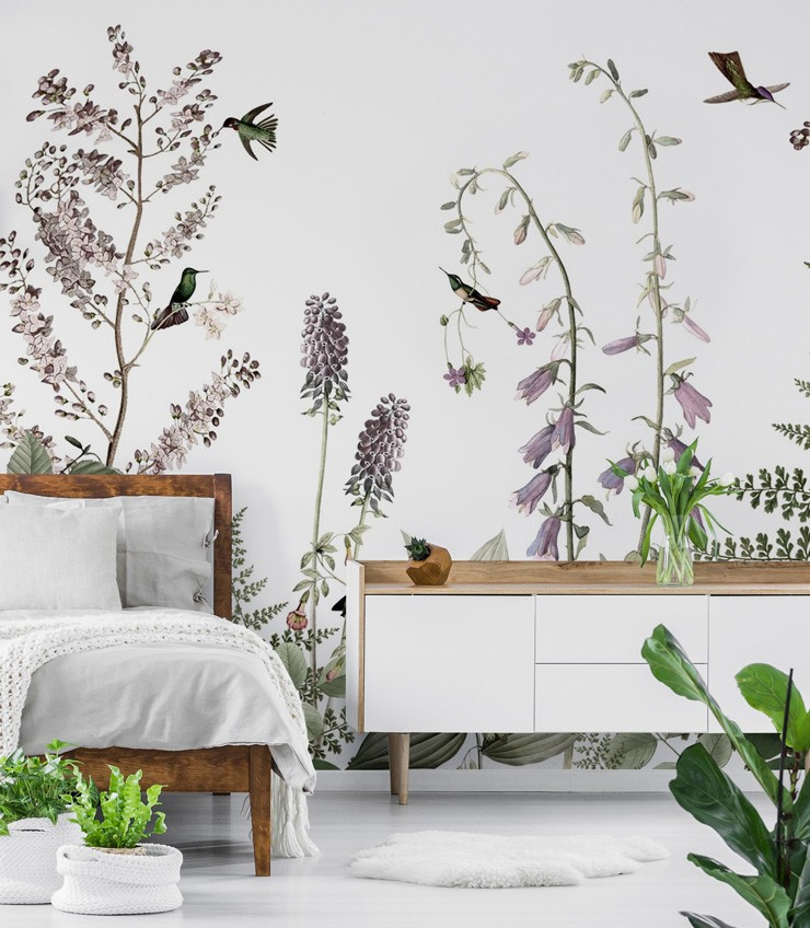 white background pale lilac and green foliage and hummingbirds illustrated wallpaper in white bedroom