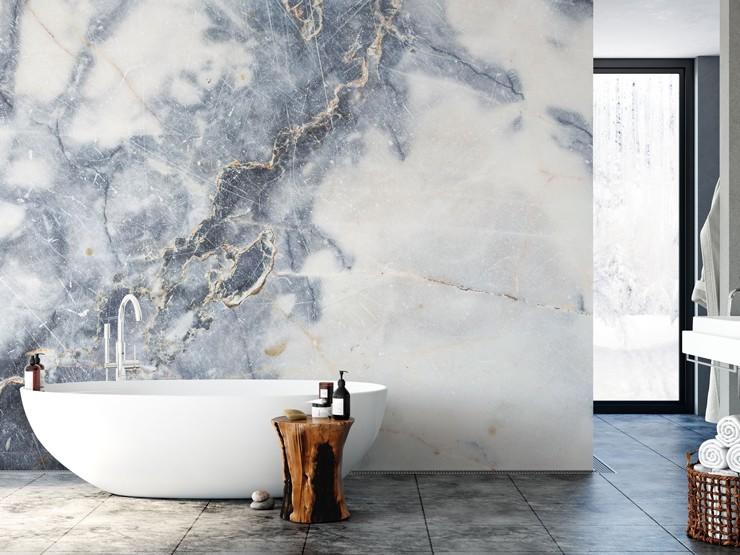 blue, grey and white marble wall mural in large bathroom with free-standing bathtub