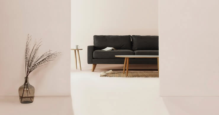 white, minimalist living room in rented property with black sofa