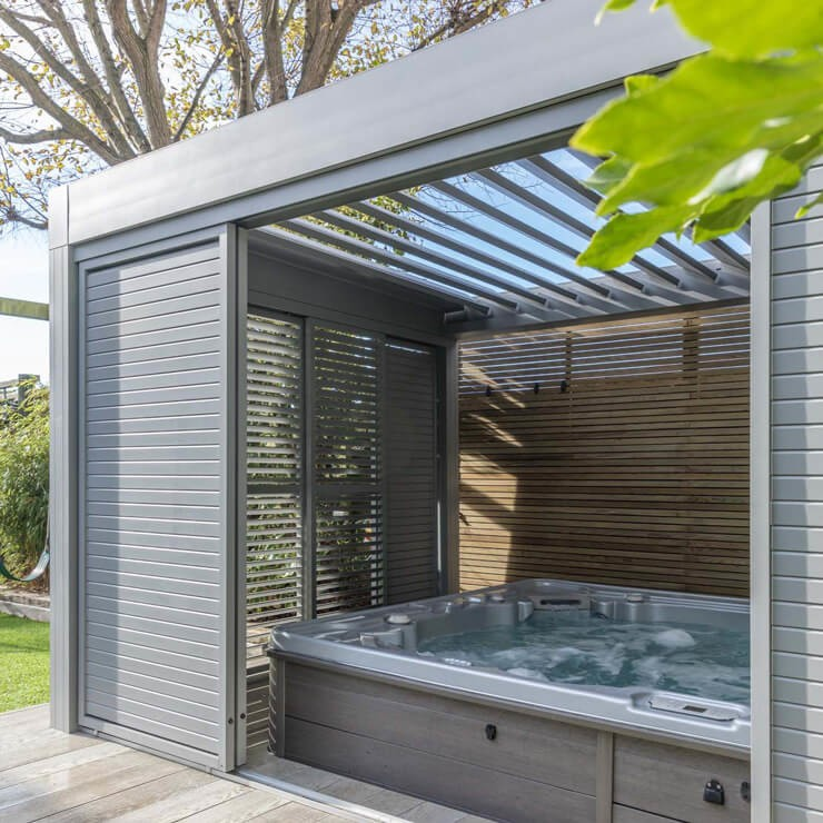 luxurious grey summer house with large hot tub inside