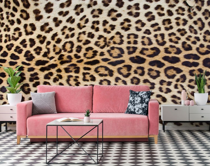 pink sofa, black and white floor and jaguar print wall mural