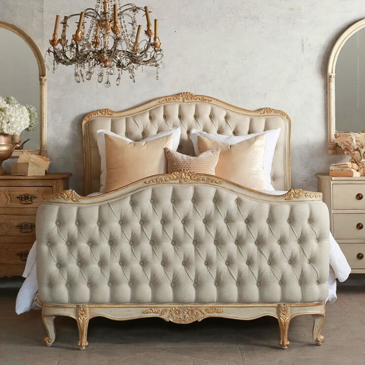 large chesterfield upholstered bed with buttons in gold tones