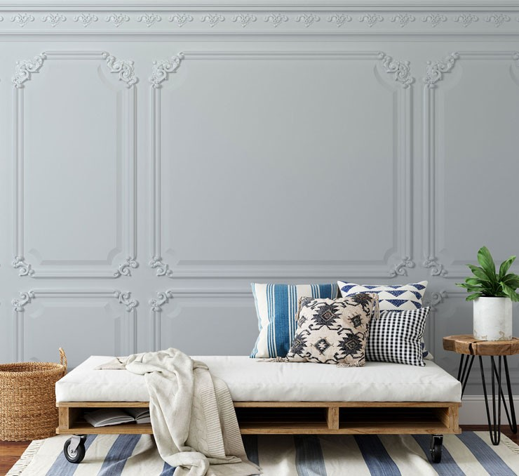 ornate white panel wallpaper in room with white and blue decor