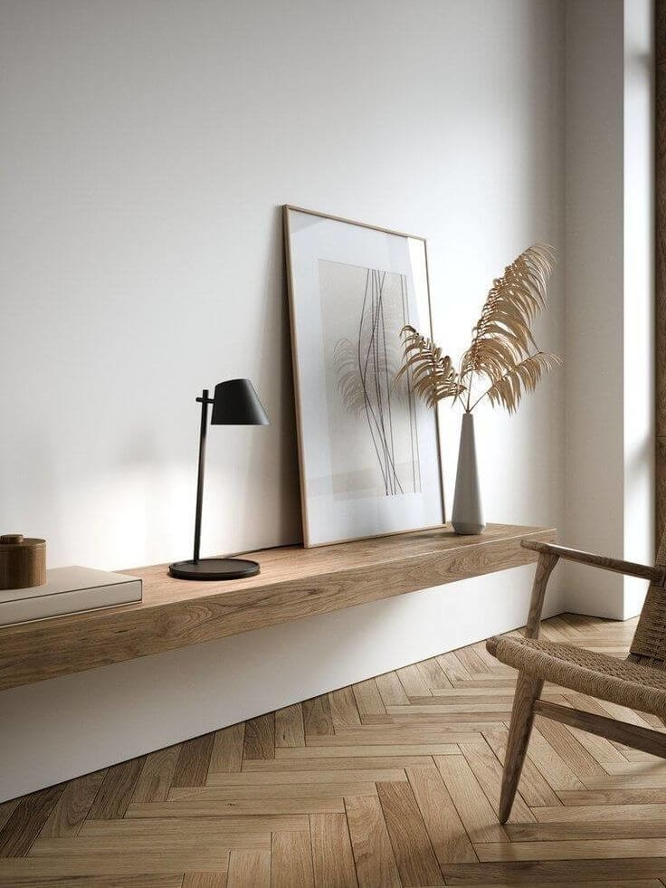 wooden table and chair with pampass grass vase