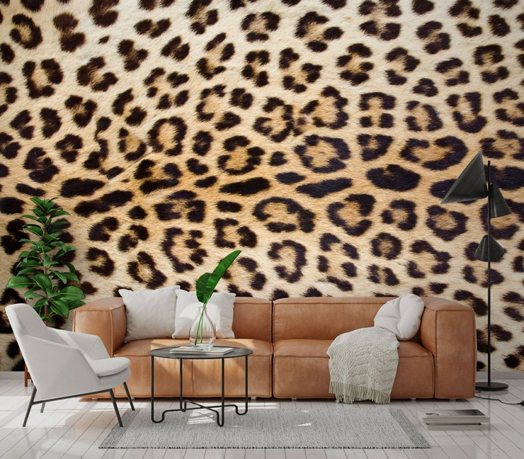 photo of jaguar's spotty coat wallpaper in lounge with brown tan leather sofa
