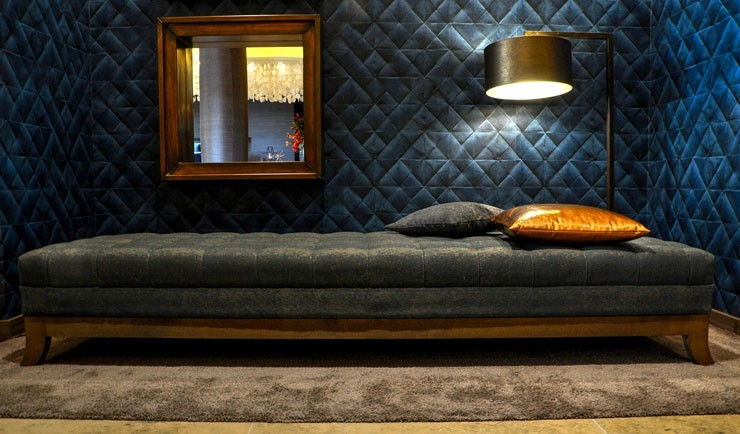 navy velvet chaise longue with dim overhead light