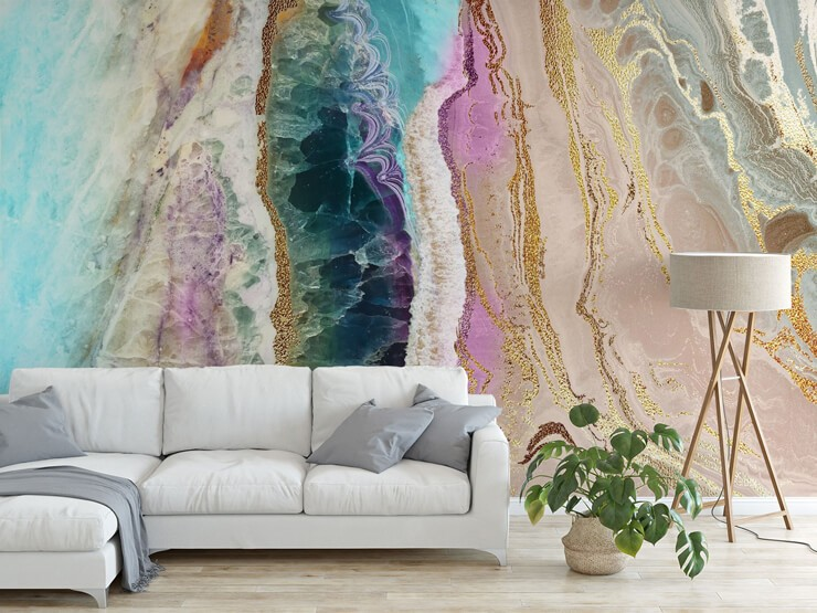 purple, grey, blue, gold colour and white geode effect wallpaper in lounge with white sofa and grey cushions