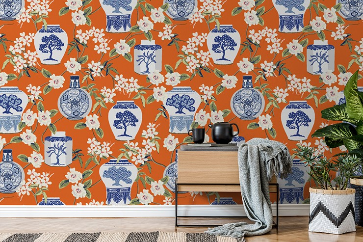 blue and white oriental pots on orange background wallpaper in trendy lounge