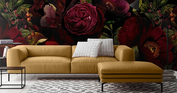 maroon dark floral illustrated wallpaper in lounge with leather mustard-yellow sofa