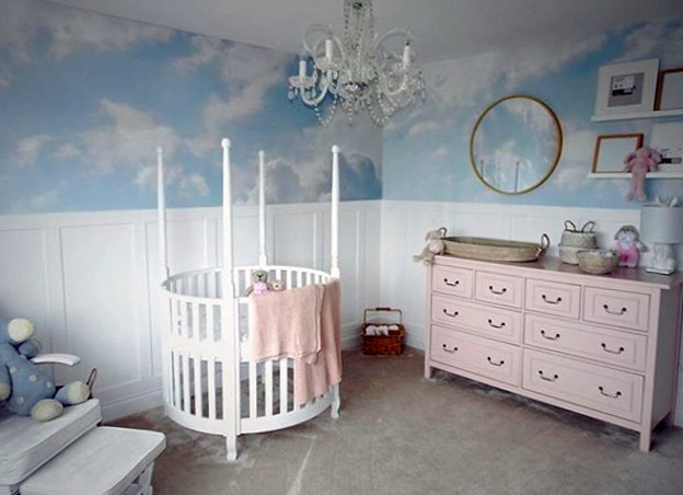 blue and white clouded sky wallpaper in pink and white nursery