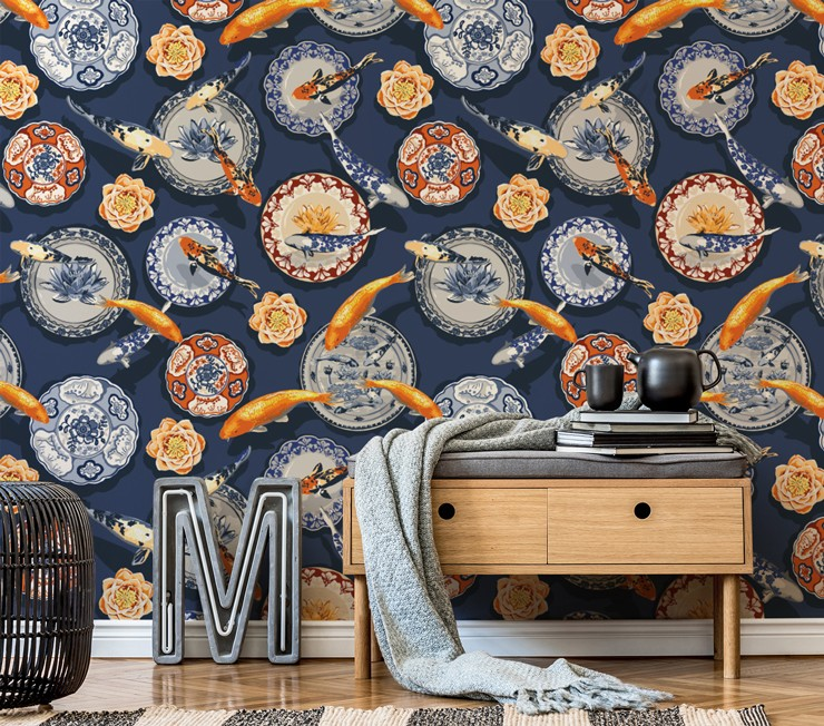 navy wallpaper with oriental plates and orange koi fish in room with sidetable and grey blanket