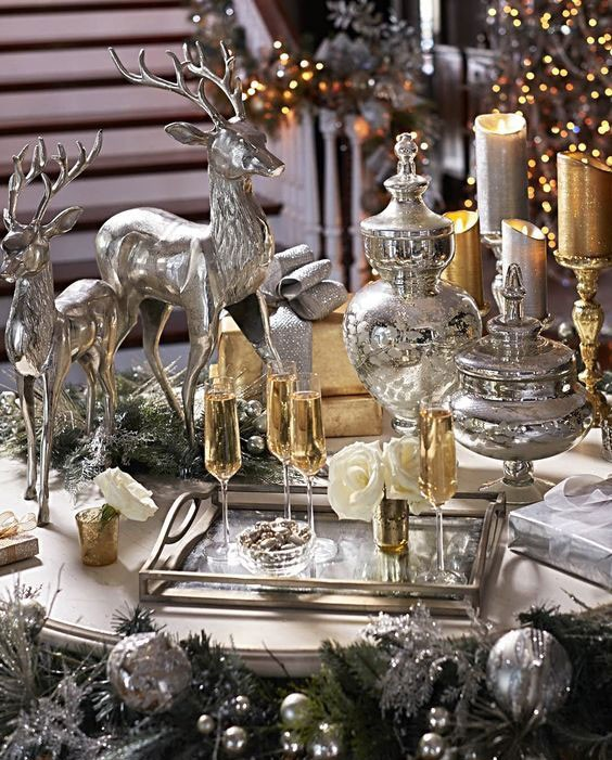 silver reindeer ornaments with silver and gold Christmas table decorations