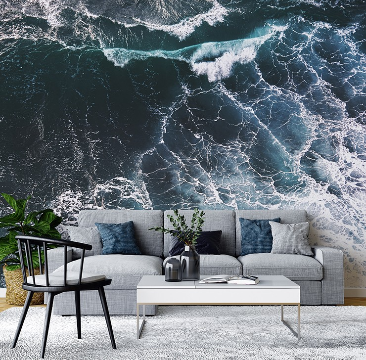 birds eye view of the oceans waves wall mural in blue and grey modern lounge
