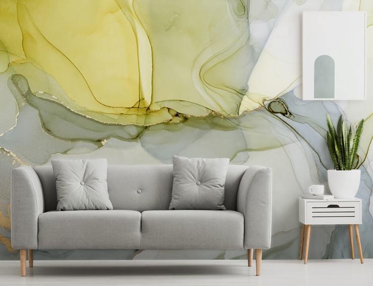 grey, white and yellow watercolour wallpaper in a lounge with a grey couch