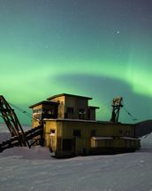 Green Northern Lights Dance Over a Gold Dredge wall mural thumbnail