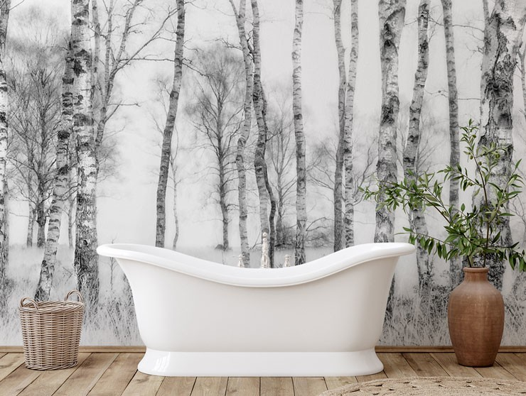 black and white birch forest wallpaper with white stand alone bath