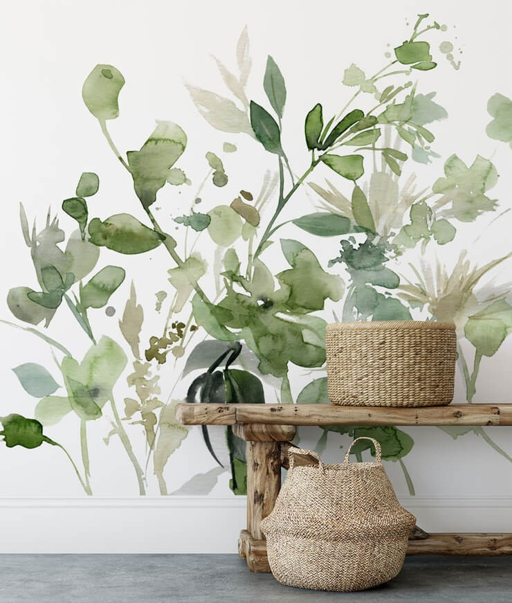 green watercolour of plant wall mural in room with wicker baskets