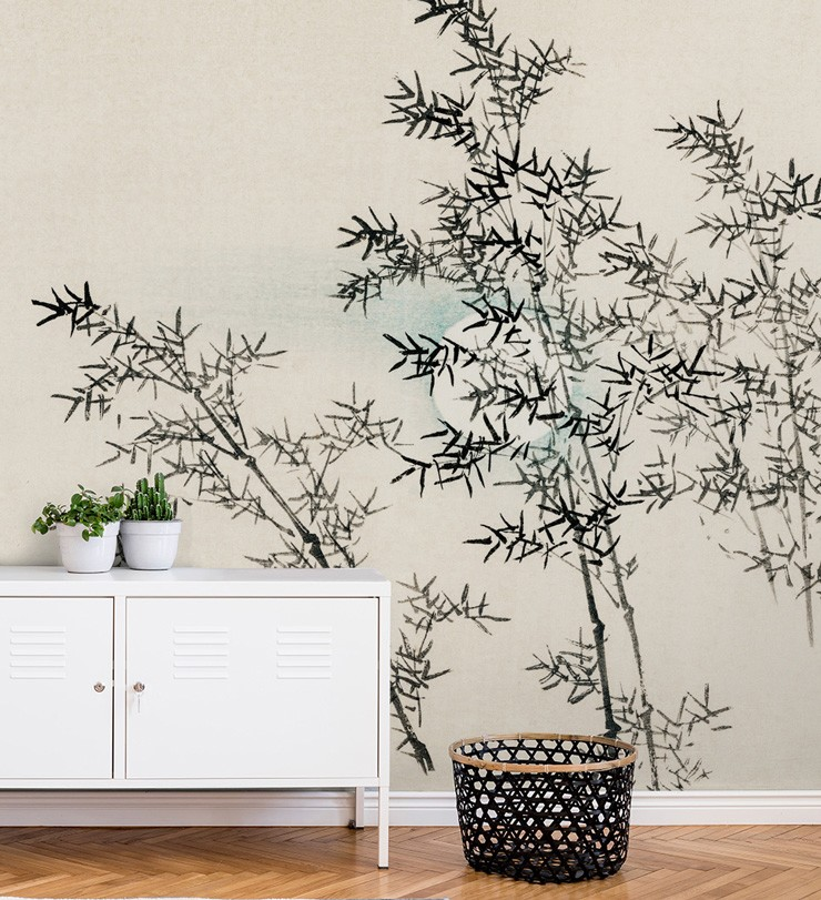 black and white bamboo wallpaper with white cabinet and black basket
