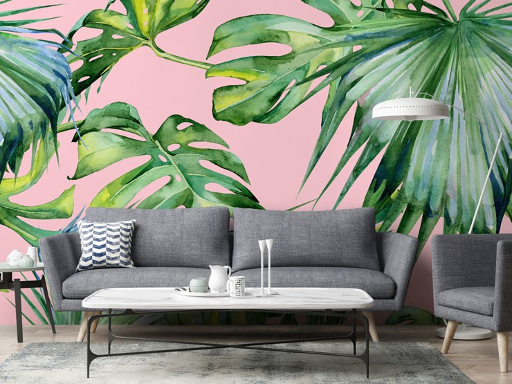 palm leaf against pink background wall mural in grey lounge