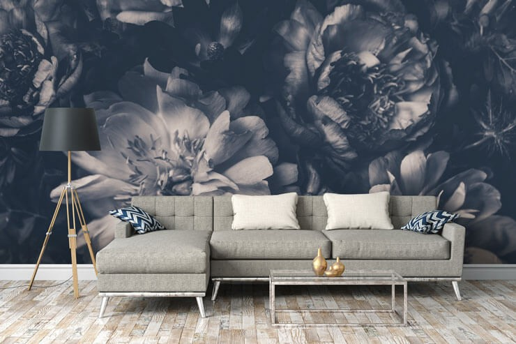 black and white floral wallpaper in trendy and cosy lounge with grey sofa