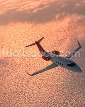 Private Jet at Sunset wall mural thumbnail