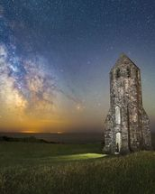 Medieval Lighthouse Next to The Milky Way wall mural thumbnail