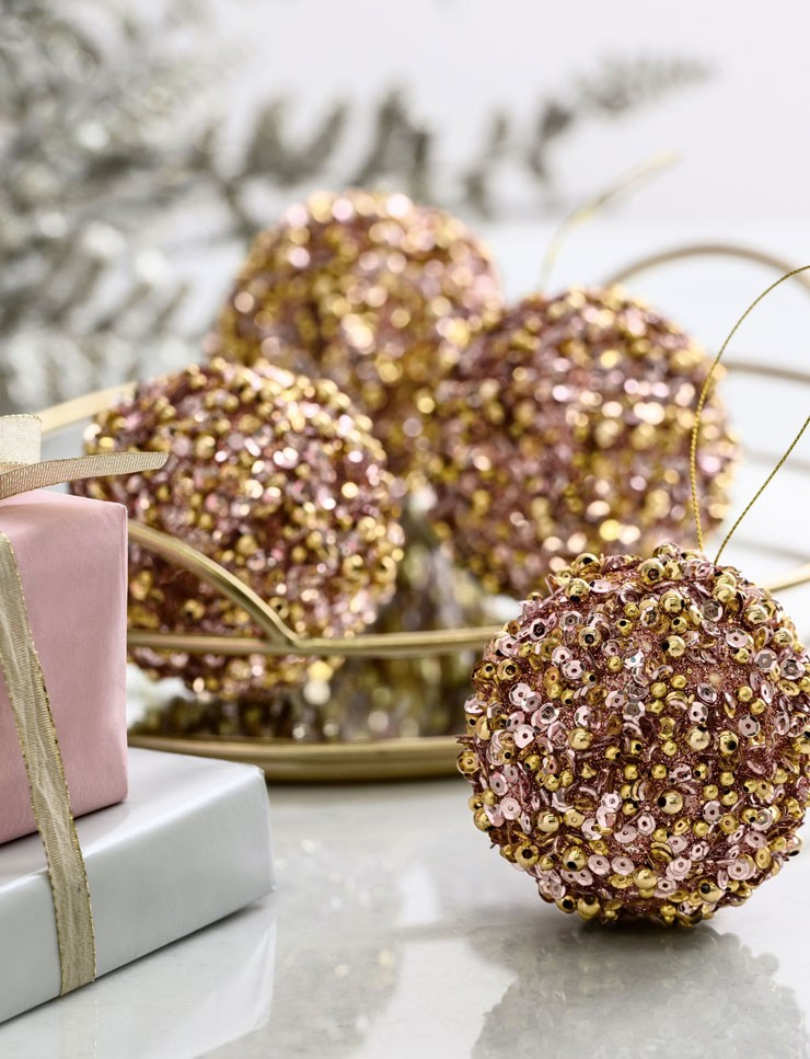 beaded gold and pink baubles close up