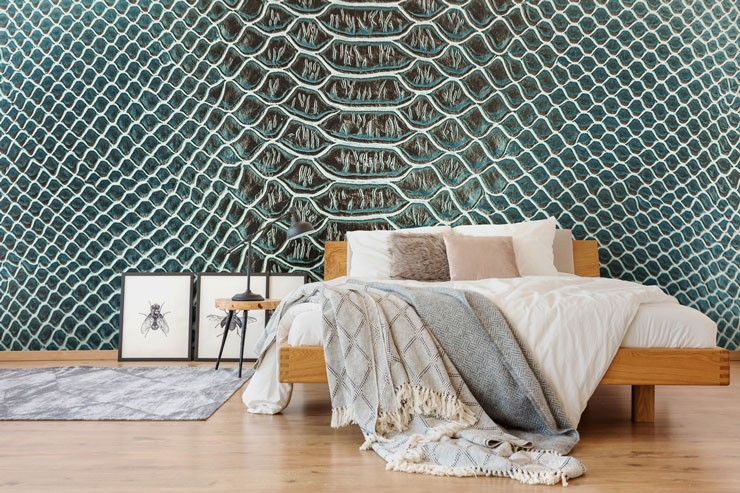 green lizard print wallpaper in trendy master bedroom