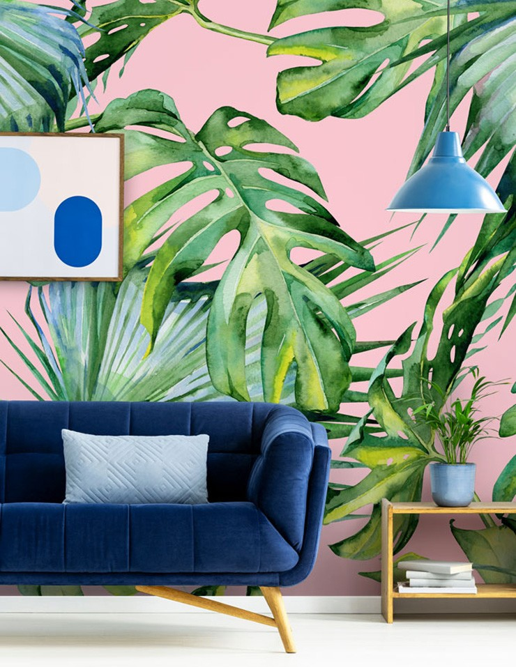 pink jungle wallpaper with leaf pattern in living room