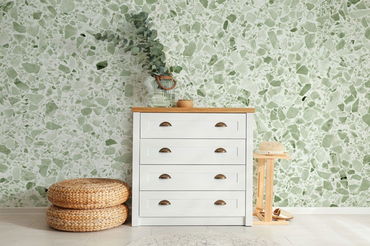 sage green and white terrazzo wallpaper in hallway with wood and white cupboard storage
