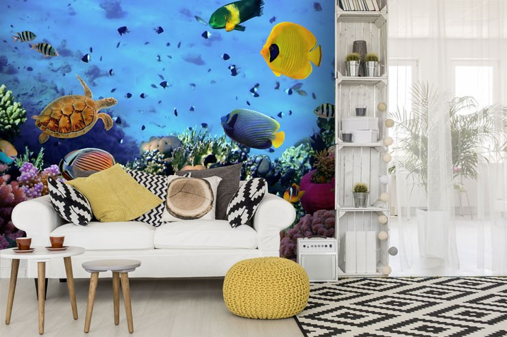 white, yellow and black lounge with tropical fish wallpaper