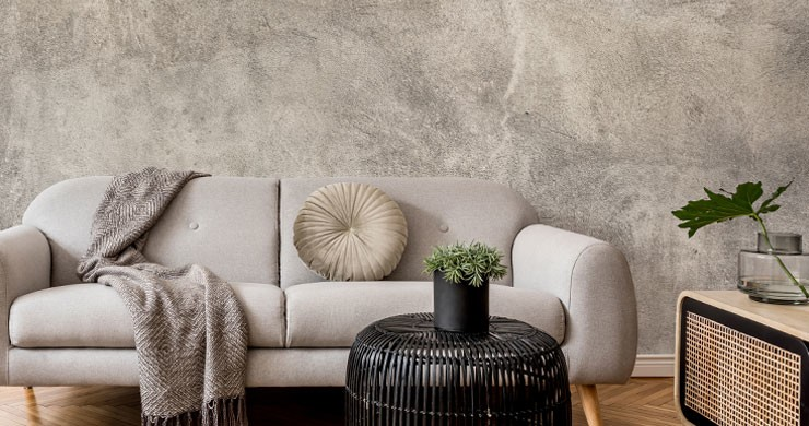 grey plaster wallpaper with elegant grey sofa, throw and cushion for perfect timeless interiors