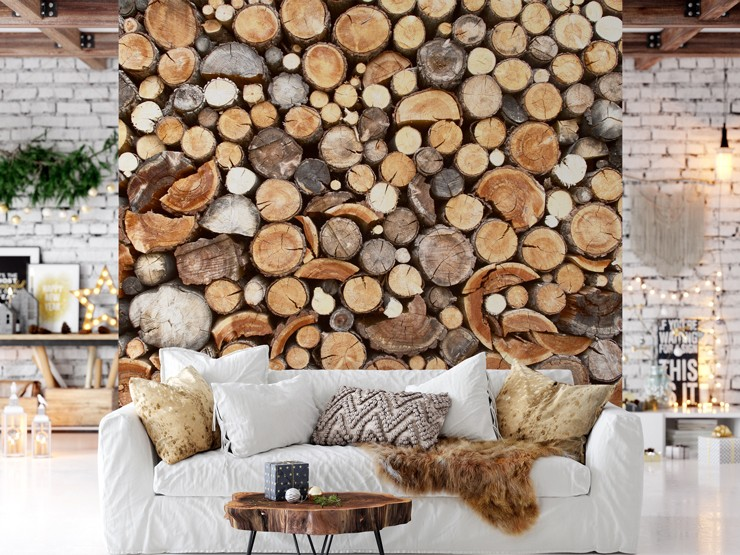 chopped logs piled up wallpaper in cosy white and tan lounge