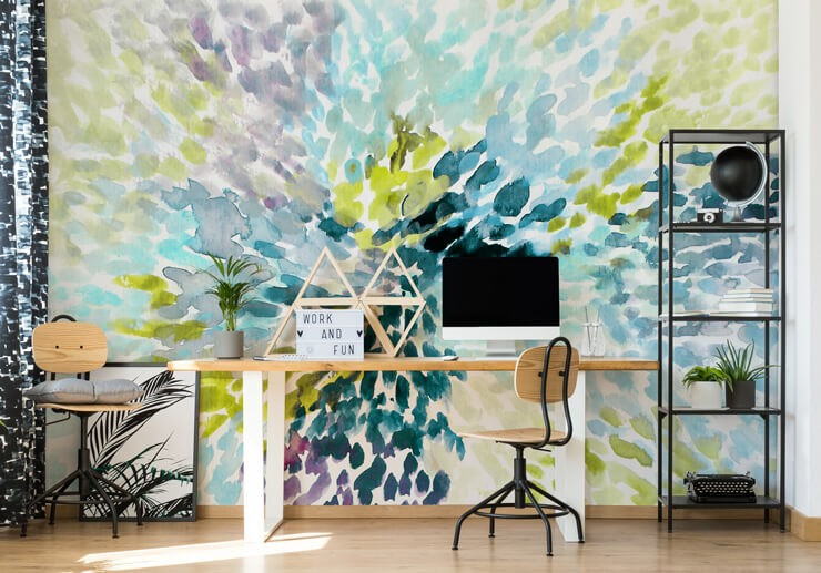 purple, teal and green explosion painting on white background in simple home office